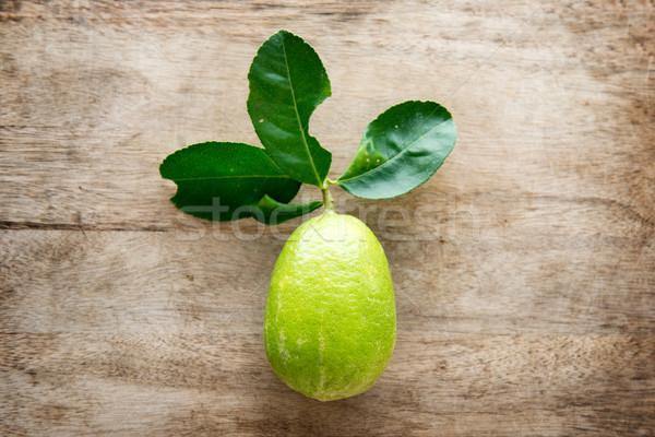 Fresh organic green lemon top view Stock photo © szefei