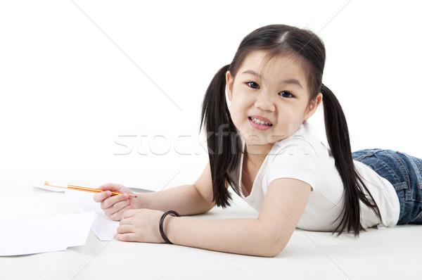 Little girl drawing Stock photo © szefei