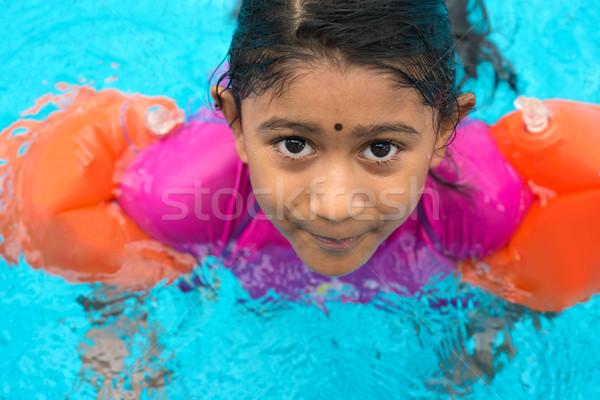 Indian child swimming Stock photo © szefei