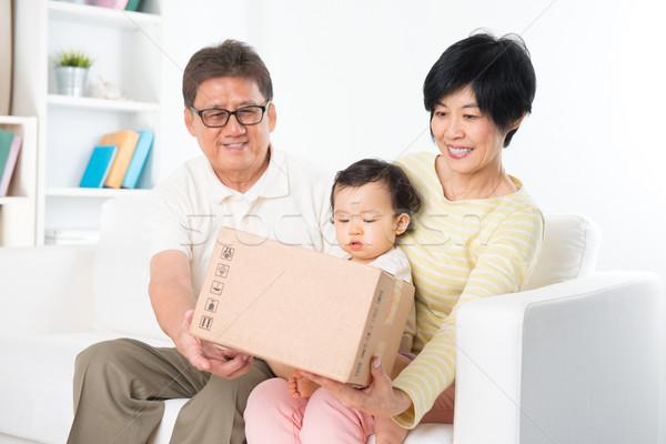 Asian family received parcel  Stock photo © szefei