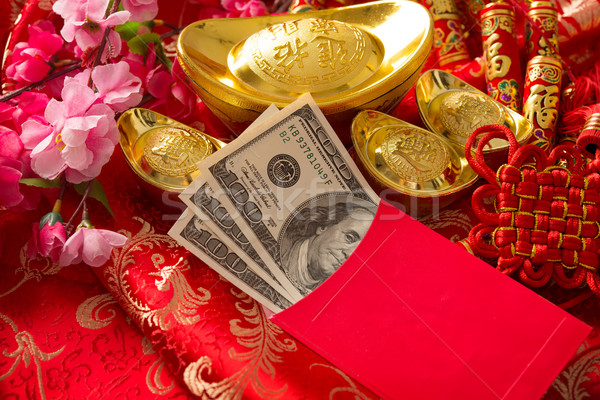 Chinese new year red packet with dollars inside Stock photo © szefei