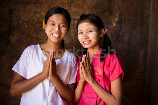 Two young Myanmar girls in welcoming posture Stock photo © szefei