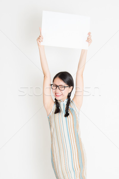 Chinese girl holding white blank paper card Stock photo © szefei