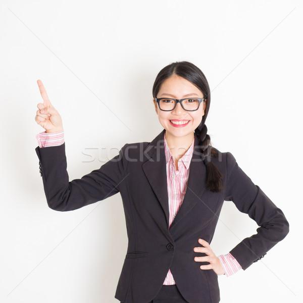 Businesswoman finger pointing something Stock photo © szefei