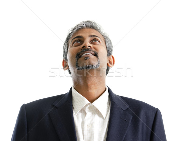 Asian Indian male looking up Stock photo © szefei