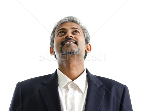 ázsiai indiai férfi felfelé néz jól kinéző érett Stock fotó © szefei