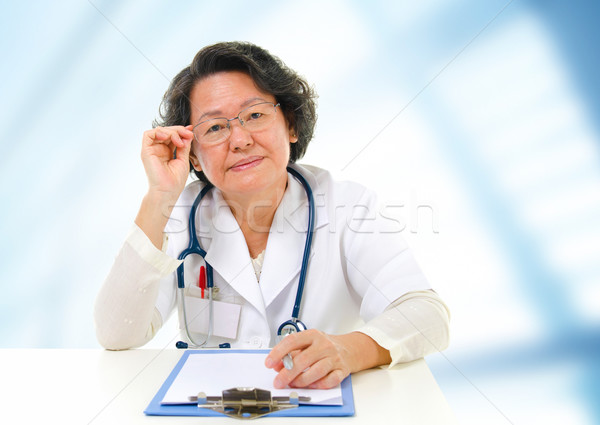 Asian senior female doctor Stock photo © szefei