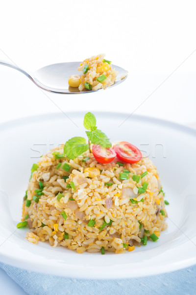 Delicious Chinese egg fried rice on dining table Stock photo © szefei