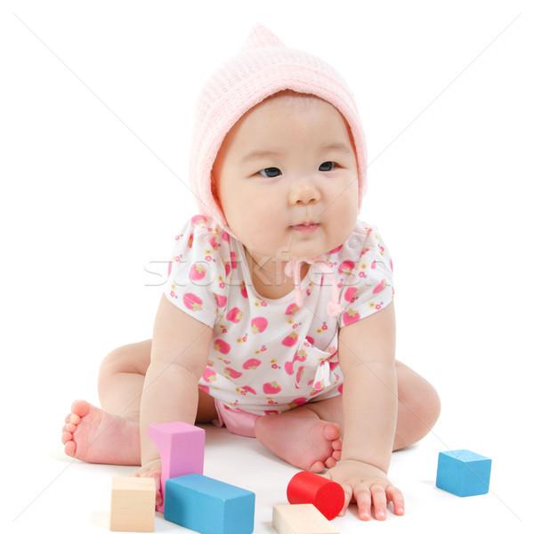 Asian baby girl playing wood blocks  Stock photo © szefei