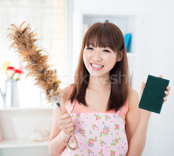 Woman cleaning house Stock photo © szefei
