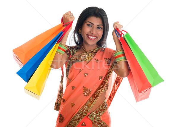 Indian woman in sari dress holding shopping bags Stock photo © szefei