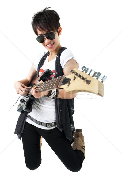 Punk Rockstar holding a guitar Stock photo © szefei