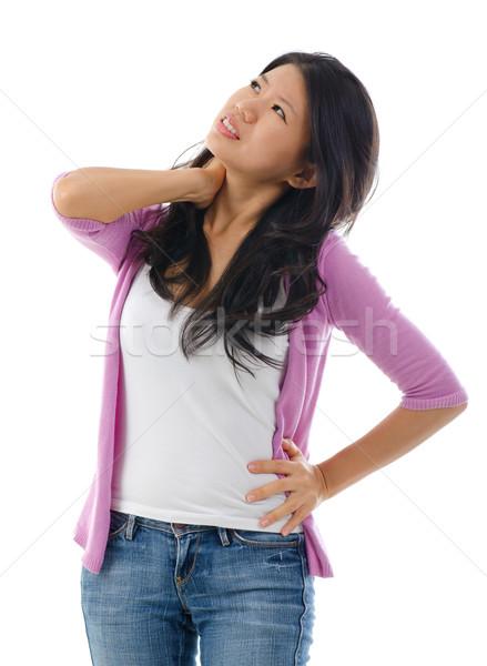 Yorgun Asya kadın boyun omuz ağrısı ayakta Stok fotoğraf © szefei