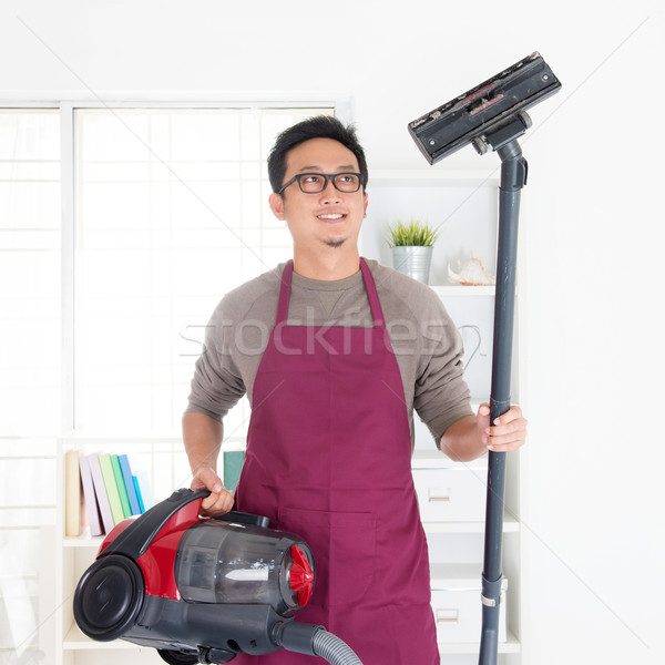 Asian man vacuuming Stock photo © szefei