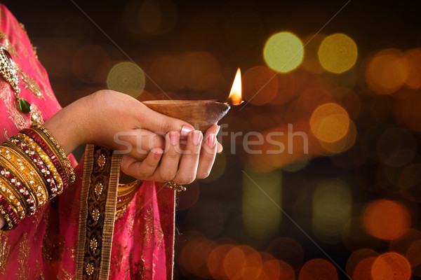 Close up Indian woman hands holding diya light Stock photo © szefei