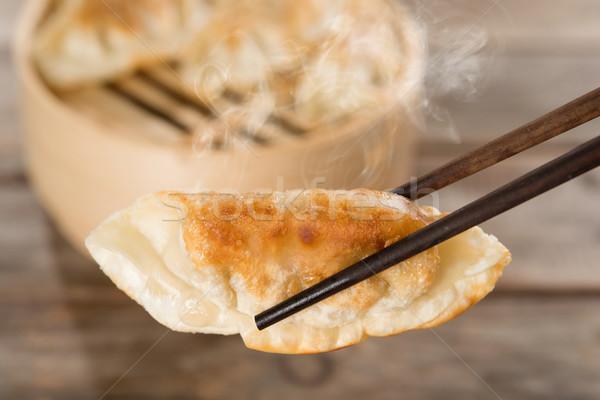 Chinese appetizer pan fried dumplings Stock photo © szefei