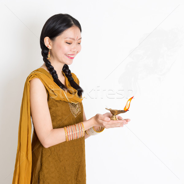 Woman holding oil lamp Stock photo © szefei
