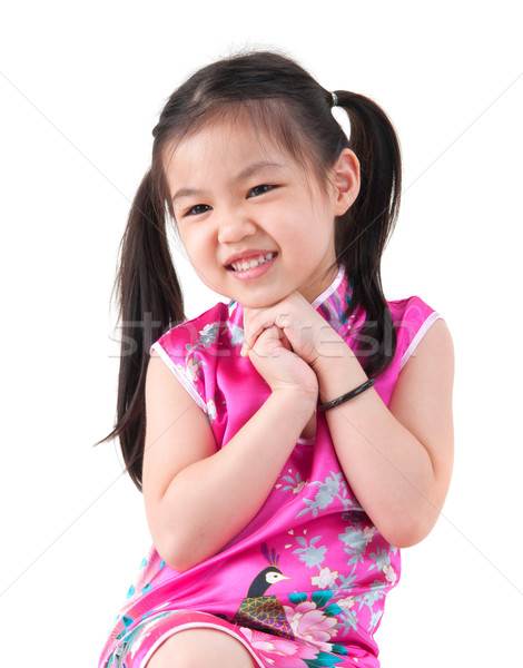 Little girl in Cheongsam Stock photo © szefei