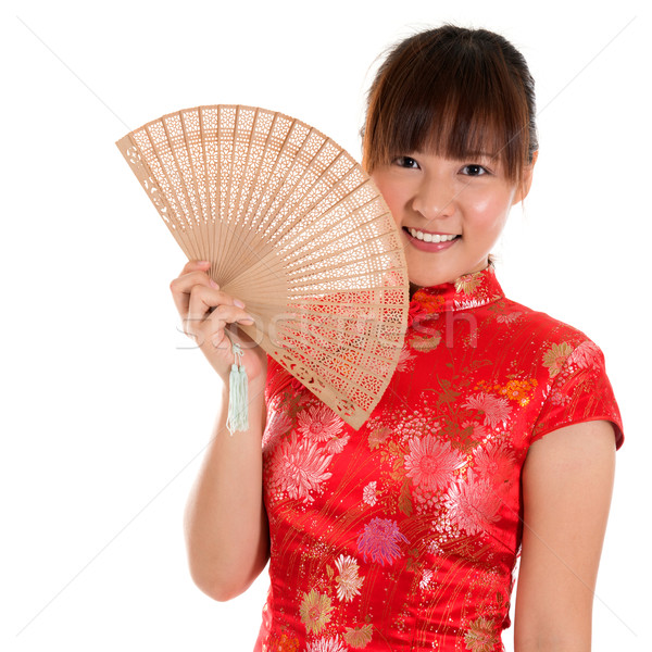 Cheongsam woman and fan Stock photo © szefei