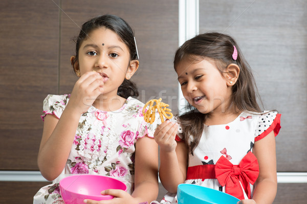Sibling eating snacks Stock photo © szefei