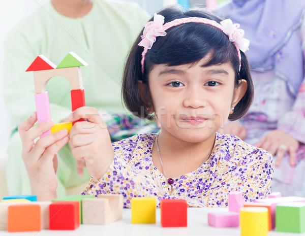Child building wooden house Stock photo © szefei