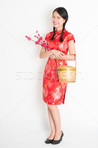 Chinese girl holding gift basket and plum blossom Stock photo © szefei