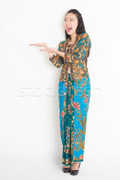Boldog lány mutat valami egészalakos portré izgatott Stock fotó © szefei