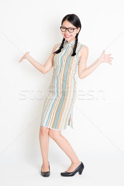 Excited Asian girl Stock photo © szefei