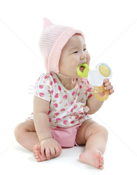 Asian baby girl teething Stock photo © szefei