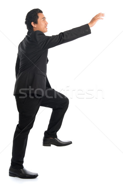 Full body Asian businessman hand reaching high Stock photo © szefei