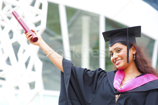 Indian in a graduation gown Stock photo © szefei