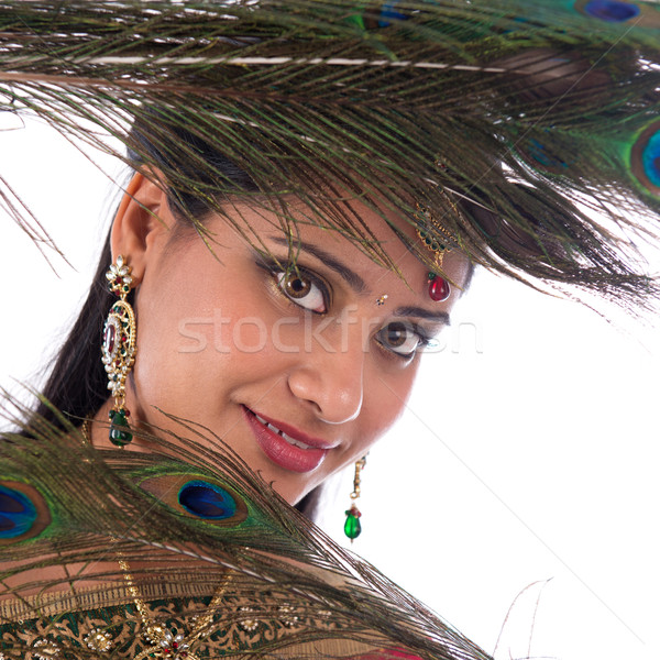 Indian girl with peacock feathers. Stock photo © szefei