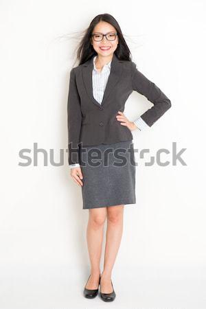 Full body smiling Asian business woman  Stock photo © szefei