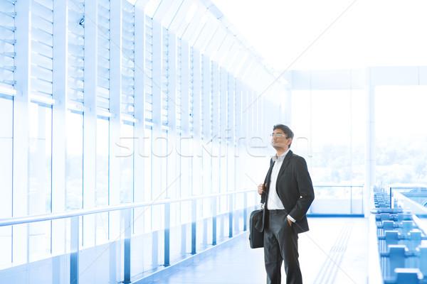Businessman at airport Stock photo © szefei