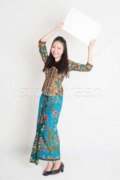 Asian girl holding placard Stock photo © szefei