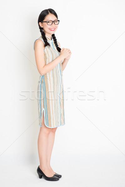 Asian woman greeting Stock photo © szefei