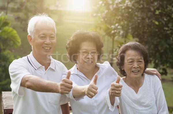Group of Asian seniors showing thumbs up Stock photo © szefei
