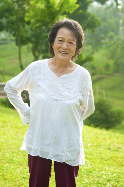 Hátfájás 80-as évek ázsiai idős nő testmozgás Stock fotó © szefei