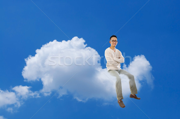 Asian człowiek posiedzenia Chmura Błękitne niebo Zdjęcia stock © szefei