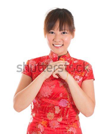 Chinese cheongsam woman greeting Stock photo © szefei