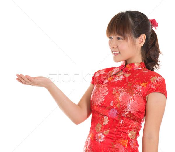 Chinese cheongsam girl showing empty palm Stock photo © szefei