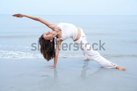 Jóga nő híd pozició tengerpart test Stock fotó © szefei
