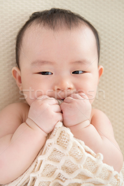 Teething Asian baby girl  Stock photo © szefei