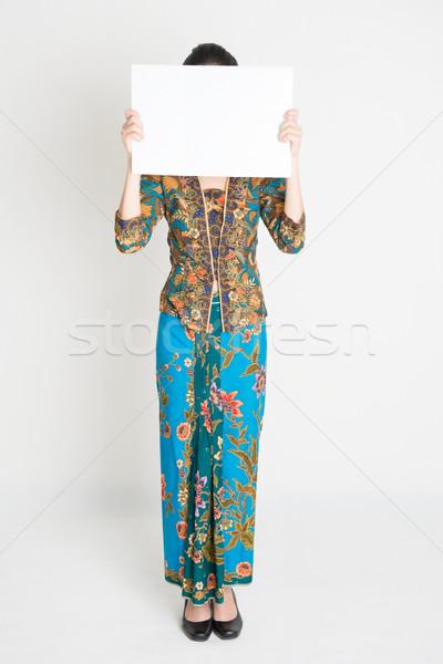 Asian girl holding placard covering face Stock photo © szefei