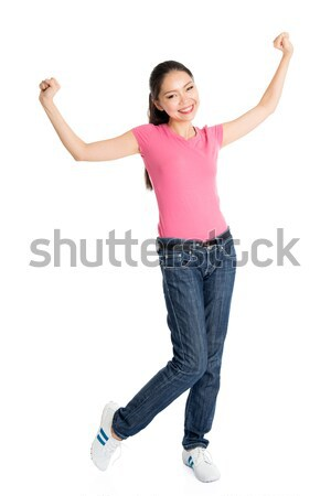 Happy young Asian girl arms raised Stock photo © szefei