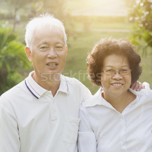 Happy Asian seniors couple Stock photo © szefei