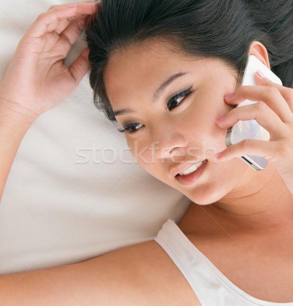 話し 電話 アジア 女性 ベッド ストックフォト © szefei