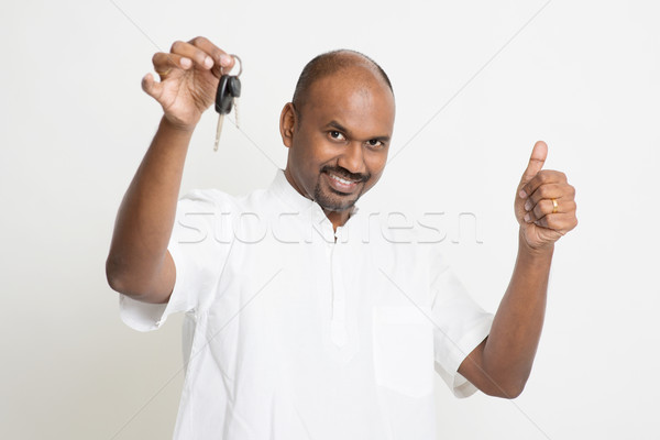 Mature Indian man holding car key and thumb up Stock photo © szefei