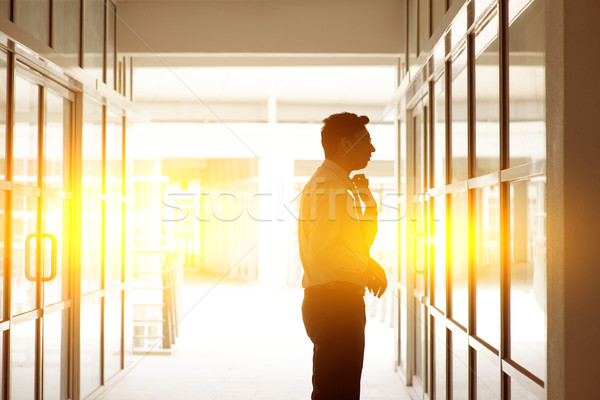 Indian businessman grooming in front office mirror Stock photo © szefei