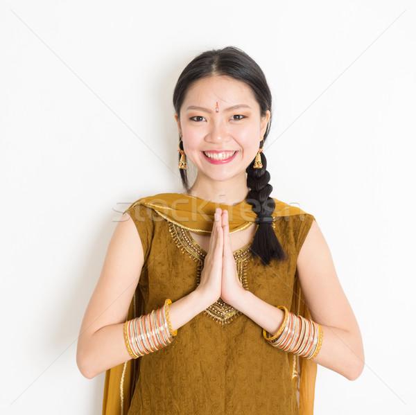 Mixed race young Indian woman greeting Stock photo © szefei